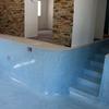 Exterior quitar piedra alrededor de piscina , echar microcemento alrededor