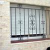 instalar rejas de protección de ventanas de metal