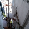 Reparar dos balcones y pared superior fachada