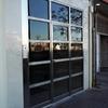 Instalar puerta en edificio en acero inoxidable