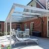 Instalar 2  techos fijos de policarbonato con estructura de aluminio