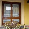 Trece ventanas en madera de iroko