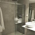Baño en microcemento con ducha de obra