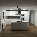 cocina abierta con isla y pavimento porcelánico