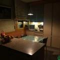 Cocina comedor totalmente equipada con muebles de madera en Zaragoza