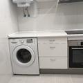 Cocina con lavadora marca Samsung