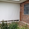 Cortina enrollable de Polyscreen 5% guiada exterior