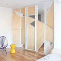 Dormitorio cerrado con biombo