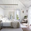 Dormitorio con tejidos de lino