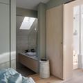 Dormitorio en tonos verde agua