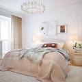 Dormitorio matrimonio con cama como eje principal