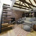 Estado reformado del espacio principal y dormitorio