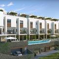 Fachada panóramica del Residencial, jardín y piscina