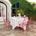 mesa en el jardín con sillas hierro