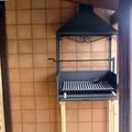 Parrilla en porche vivenda prefabricada