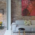 salón con muro de ladrillo tipo loft