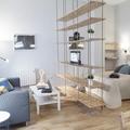 Salón pequeño conectado con el dormitorio