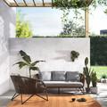 Terraza con pérgola y sillones