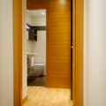 trasdosado de madera en dormitorio