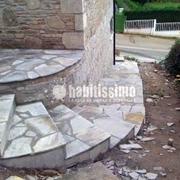 Distribuidores Porcelanosa - Construcción de casa rústica en Oleiros