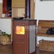 Estufa de leña con cocina económica instalada en Asturias MODELO VISPA color marrón