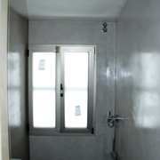 Baño con microcemento gris perla