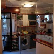 Cierre cocina americana con salón vidrio en Vizcaya