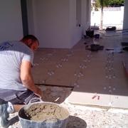 Colocación pavimento rectificado 60*60 en porche, Alicante