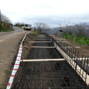 CONSTRUCCIÓN DE MURO EN LA CARRETERA DE ACCESO A MUÑÓN CIMERO