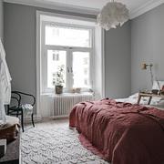 Dormitorio con textiles en rojo