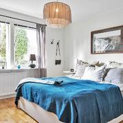 Dormitorio en gris y azul