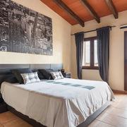 Dormitorio: la fusión entre el minimalismo y el entorno rústico