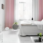 dormitorio-salón en rosa