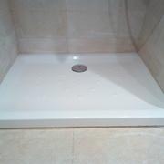 canvi de plat de dutxa