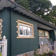Distribuidores Beissier - Pintado de fachada en Vega de Villafufre