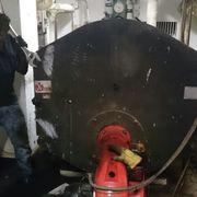 Limpieza (deshollinacion) de caldera comunitaria y su chimenea salida monoxido