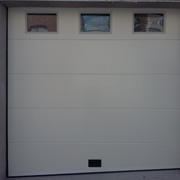 Puerta seccional panel liso