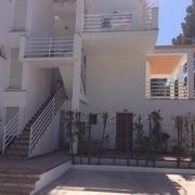 Tiendas Roca - Rehabilitación y pintura de edificio en Puerto de Pollença