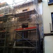 Restauracion de fachada y alero de madera tipo arabe