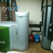 Instalación de caldera de biomasa combinada con instalación solar para la producción de agua caliente