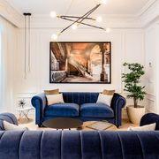 Salón clásico con sofá Chesterfield