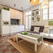 Salón con cocina abierta