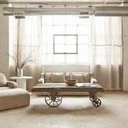 Salón industrial en tonos beige