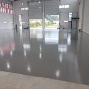 Distribuidores Kerakoll - Pintado suelo pabellon con epoxi.