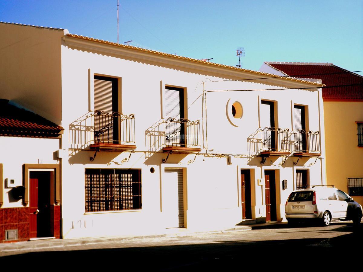 Edificio bifamiliar con local
