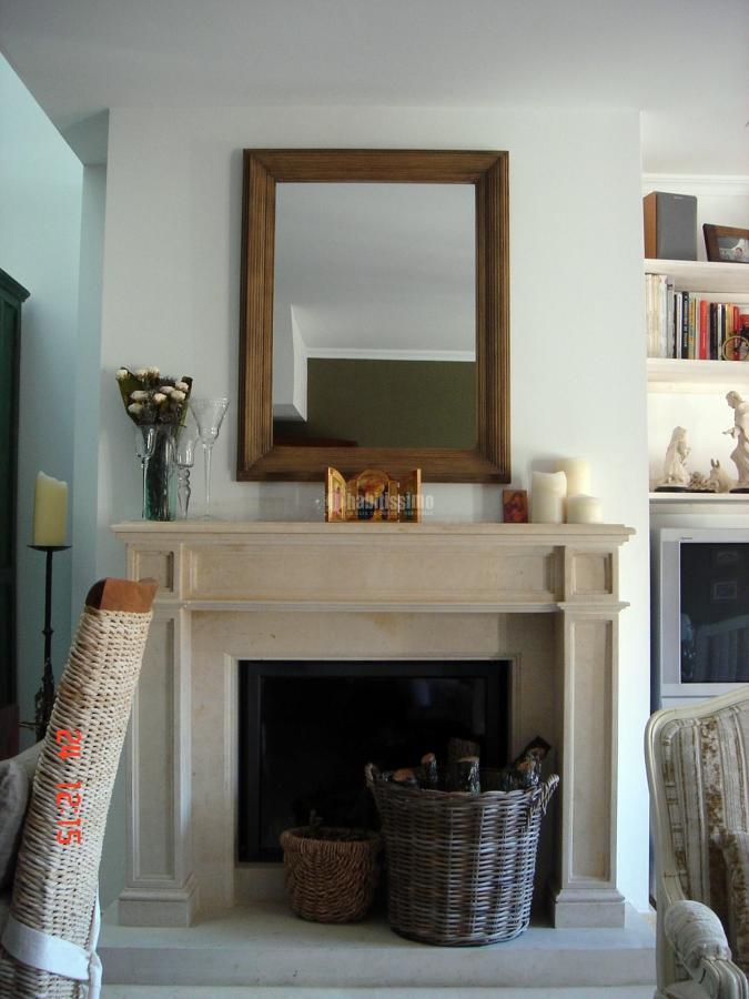 Reforma vivienda con chimenea
