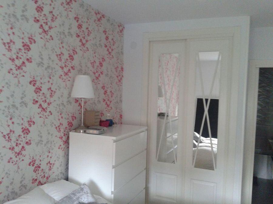 Alisado papel pintado ideas pintores for Como empapelar puertas