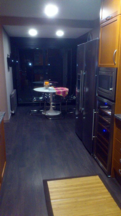 ampliacion de cocina en cristalera, parquet y cocina
