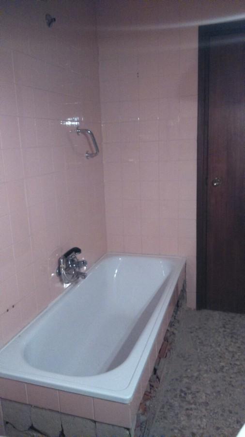 Baño azulejo rosa