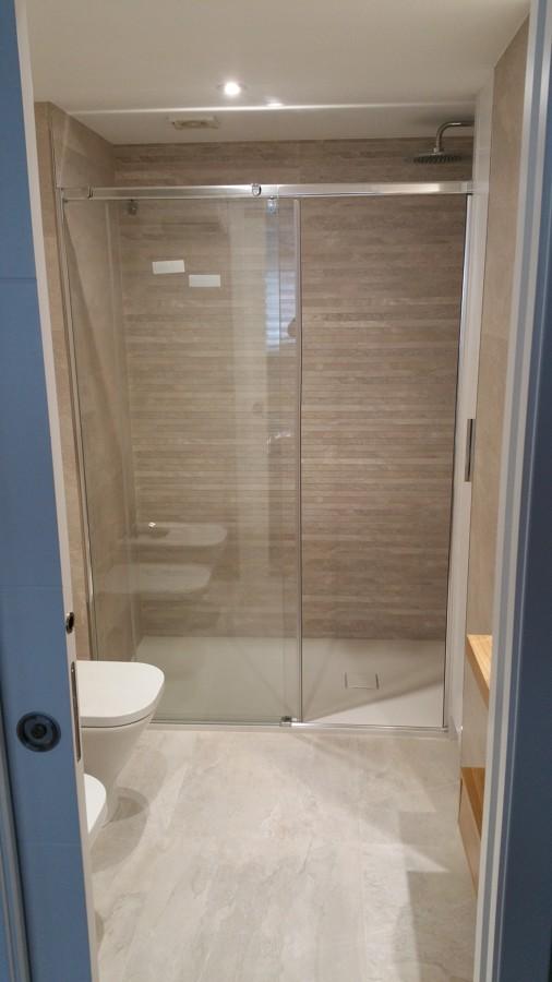 Baño piedra beige